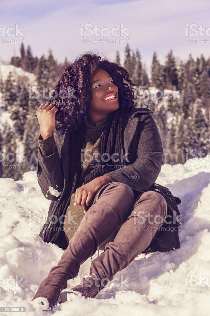 Happy African woman in winter stock photo