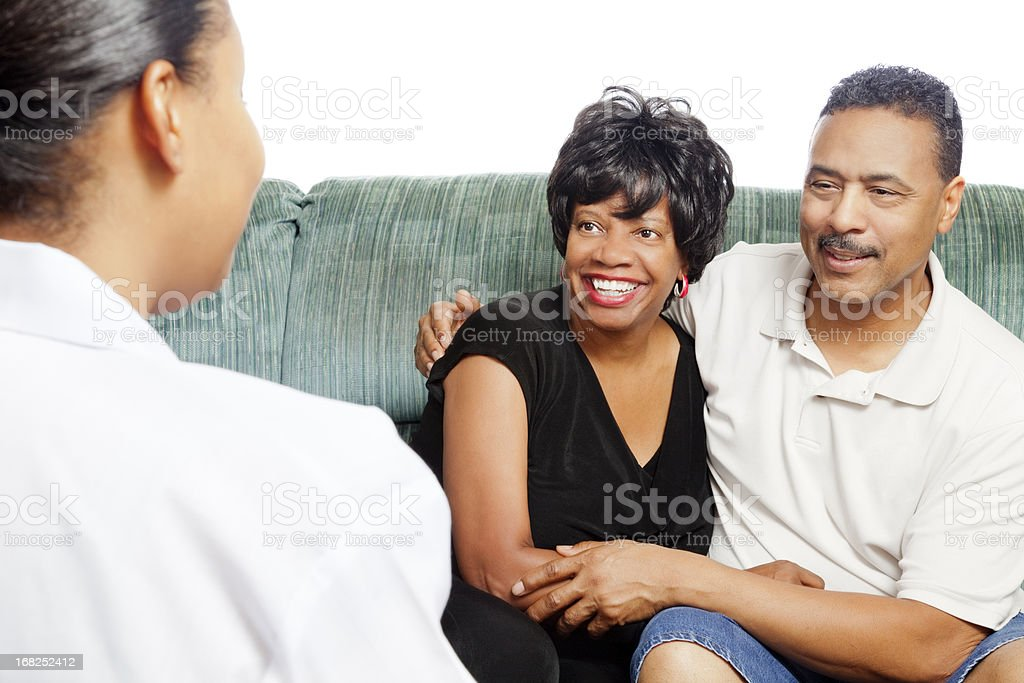 Happy african-american couple at the marriage counselor on white royalty-free stock photo