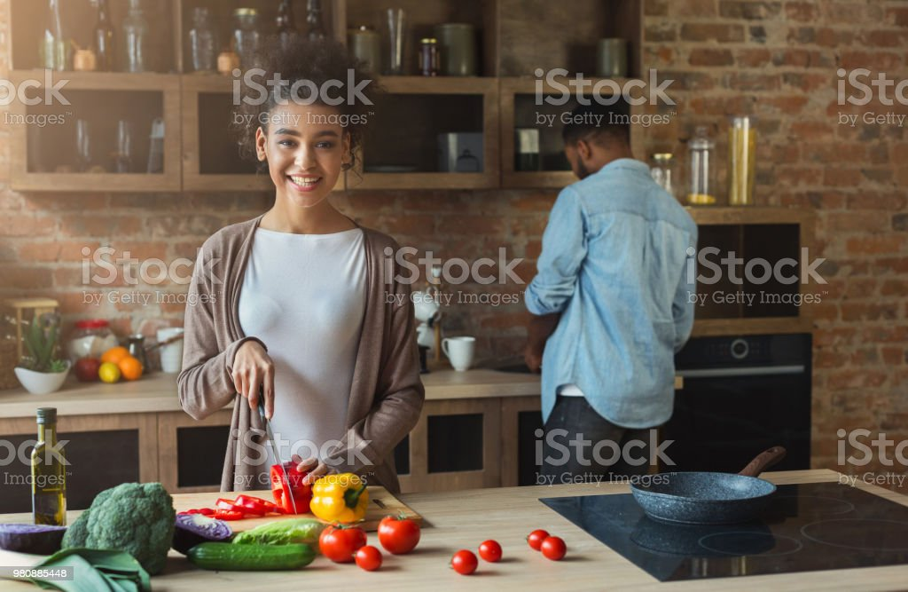 Happy african-american family cooking in loft kitchen stock photo