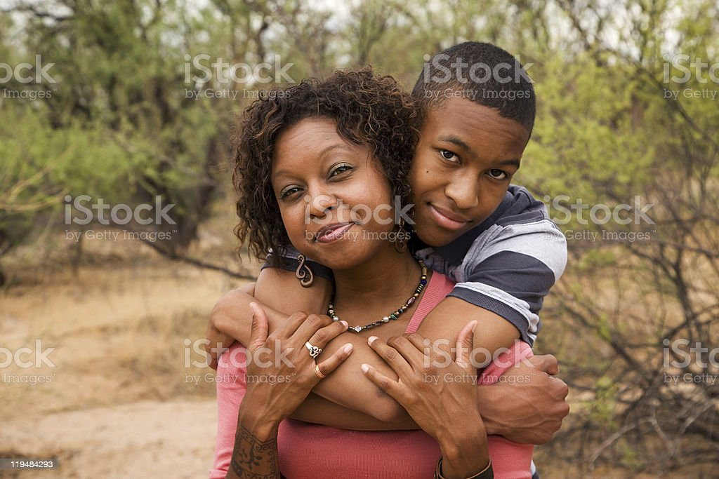 Happy African-American family outside stock photo