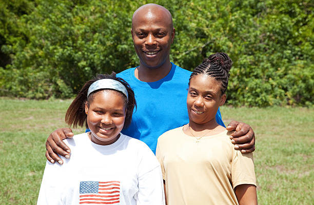 happy african-american family - gold tooth stock photos and pictures