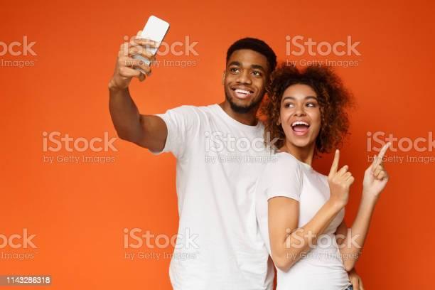 Happy africanamerican man and woman making selfie picture id1143286318?b=1&k=6&m=1143286318&s=612x612&h=of w4iqi8ddkacrmrggxhiakx lixo hbjvzslinxpi=