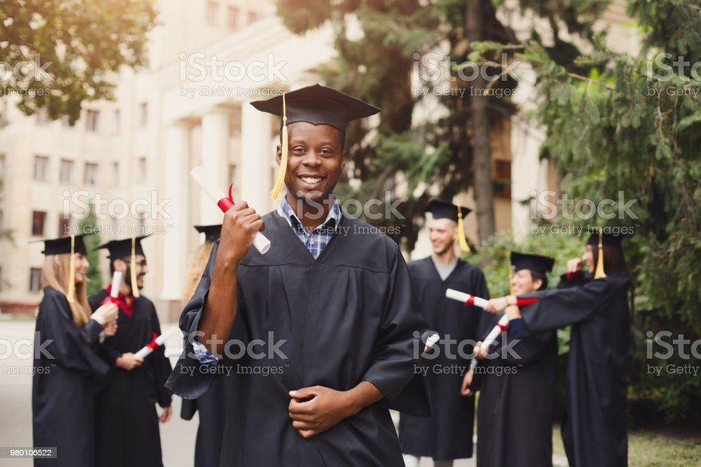 Happy african-american man on his graduation day stock photo
