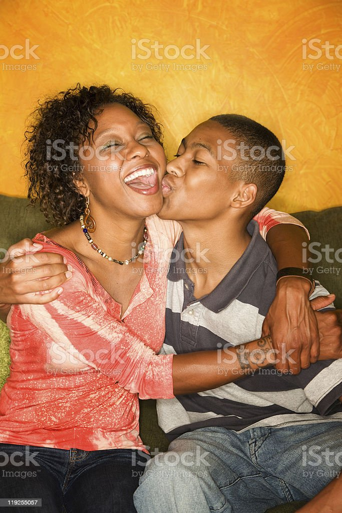 Happy African-American woman and teen boy royalty-free stock photo