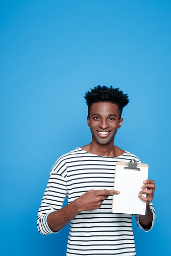 Happy Afro American Guy Holding Clipboard Stock Photo - Download Image Now
