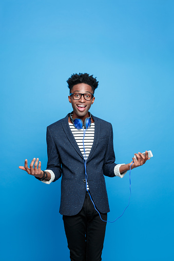 Happy Afro American Guy Holding Smart Phone In Hand Stock Photo - Download Image Now