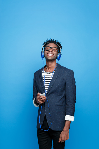 Happy Afro American Guy Using A Smart Phone Stock Photo - Download Image Now