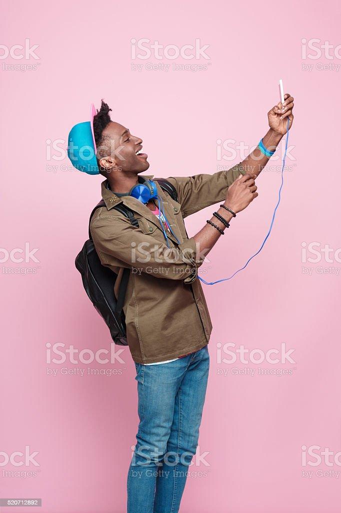 Happy afro american guy wearing headphone stock photo