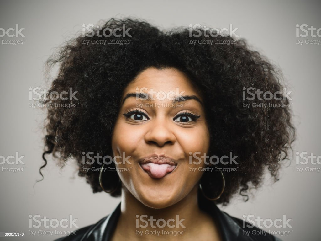 Happy afro american woman grimacing against gray background stock photo
