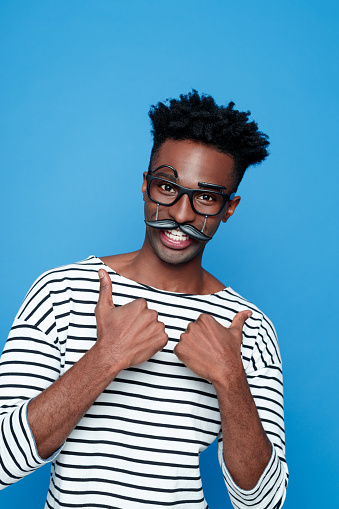 Happy Afro American Young Man Wearing Funny Glasses Stock Photo - Download Image Now