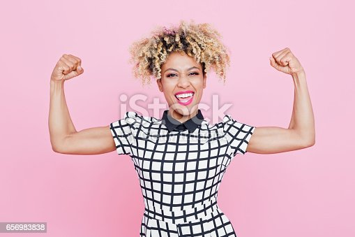 istock Happy afro american young woman flexing arms 656983838