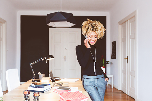 Happy Afro American Young Woman In A Home Office Stock Photo - Download Image Now