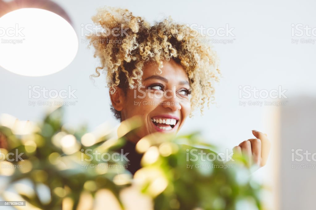 Happy afro american young woman laughing Beautiful afro american young woman laughing, close up of face. Adult Stock Photo