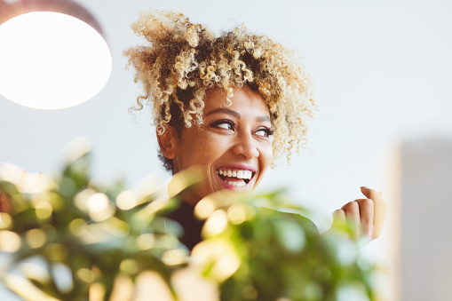 Happy Afro American Young Woman Laughing Stock Photo - Download Image Now