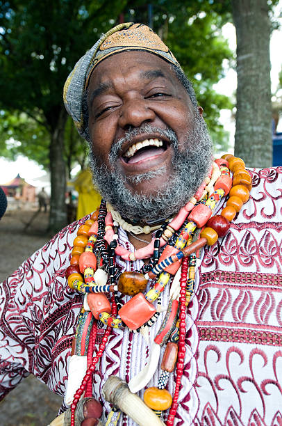 Happy Afro caribbean Man Close up picture of a laughing afro caribbean bearded mature man  wearing an african hat haitian ethnicity stock pictures, royalty-free photos & images
