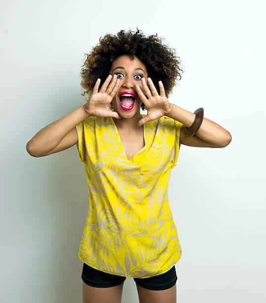 Happy Afro Woman Shouting stock photo