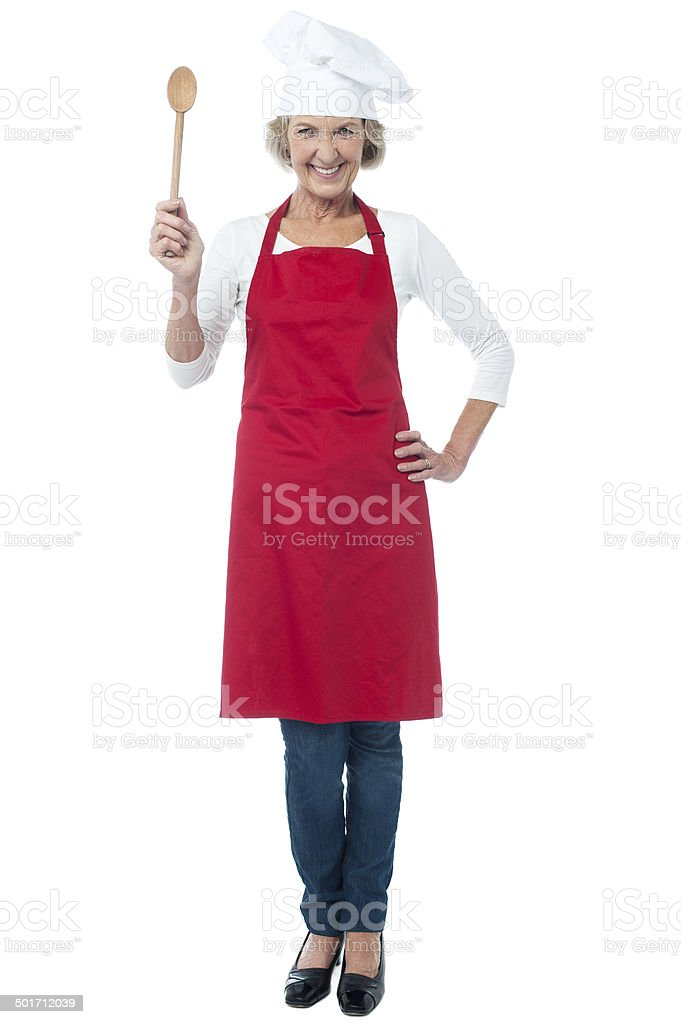 Happy aged chef holding wooden spoon - Royalty-free Active Seniors Stock Photo