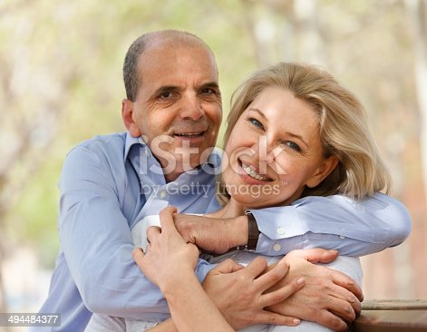 510491454 istock photo Happy aged lovers hugging each other and laughing 494484377