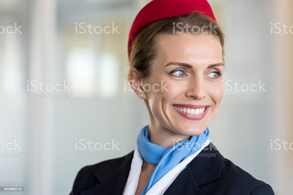 Happy air hostess smiling stock photo