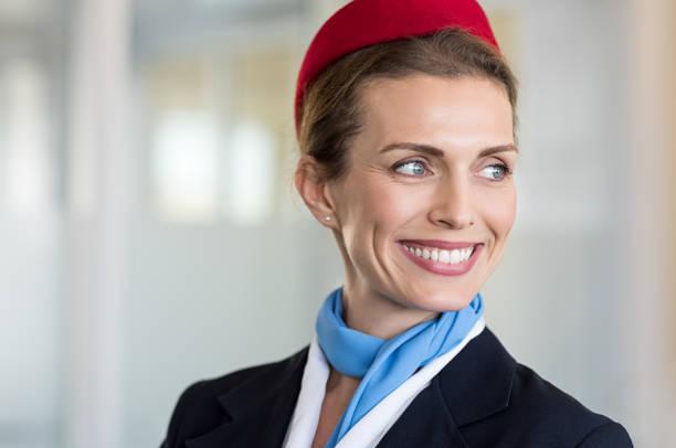 Happy air hostess smiling stock photo