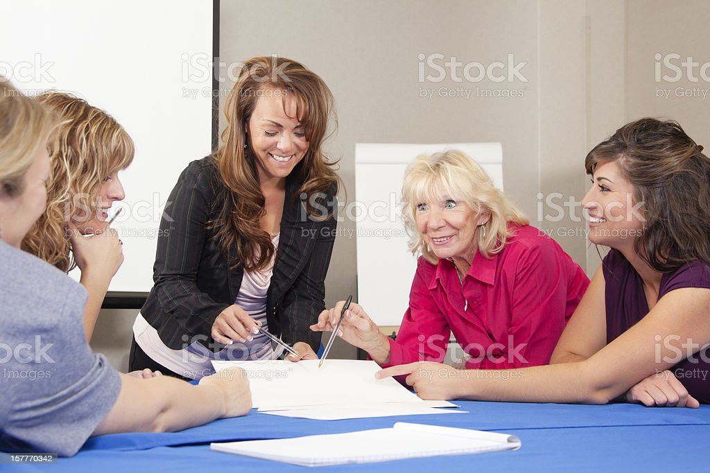Happy all women business team at the meeting royalty-free stock photo