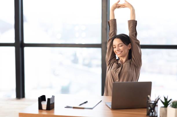 happy american girl stretching body at her home - riposarsi foto e immagini stock