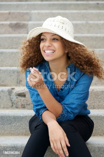 186534921 istock photo Happy and attractive young woman laughing outdoors 186396384