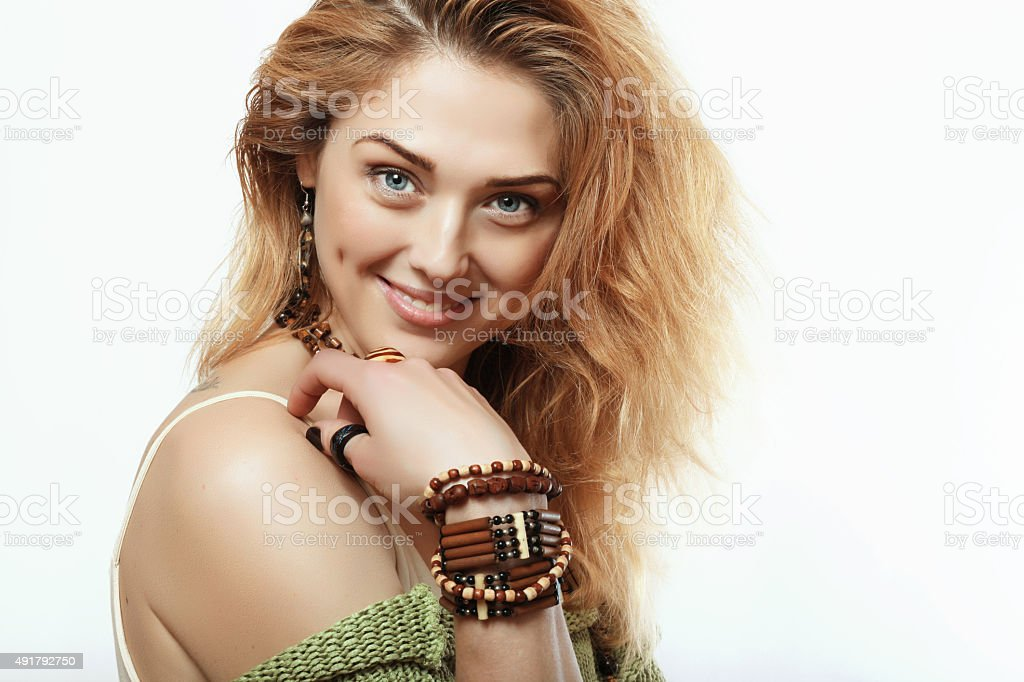 Happy and beautiful girl with the decorations on the hands stock photo