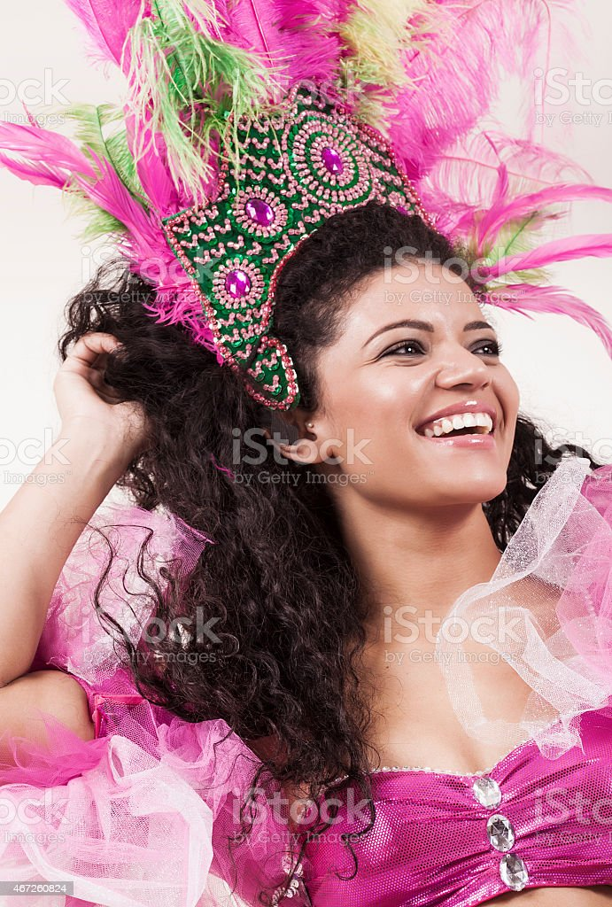 Happy and beautiful samba dancer wearing traditional pink costum stock photo
