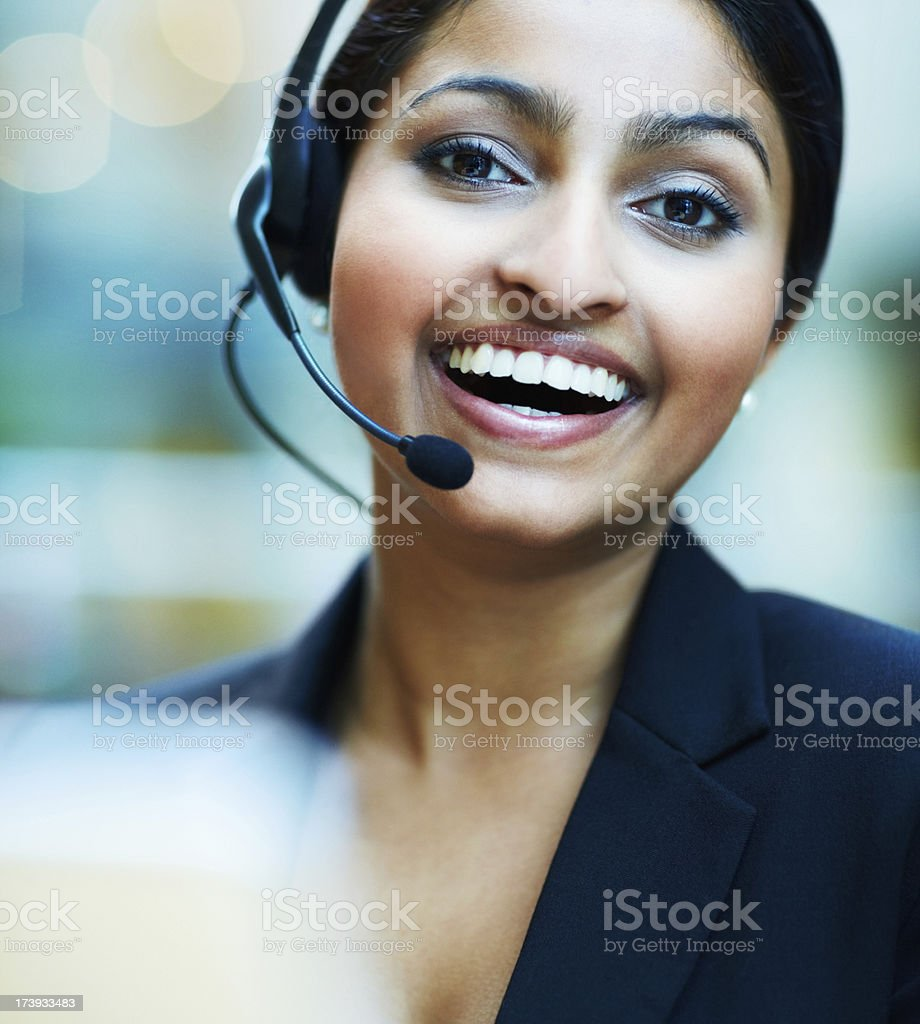 Happy and cheerful business woman using headset royalty-free stock photo