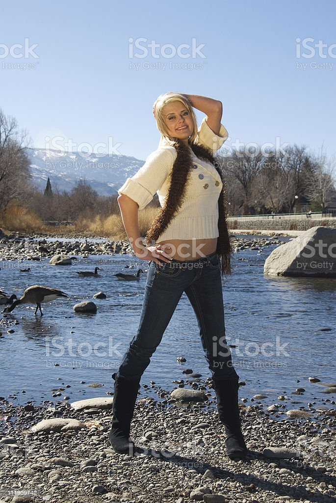 Happy and confident young woman enjoying outdoors in the spring royalty-free stock photo
