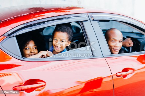 972962180istockphoto Happy and excited African American family taking a road trip with their car - Happy family togetherness concept 934259480