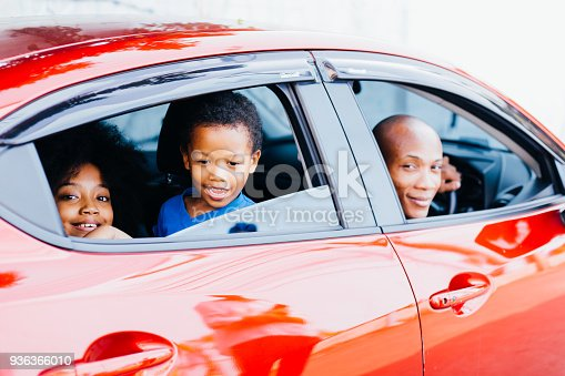 972962180istockphoto Happy and excited African American family taking a road trip with their car - Happy family togetherness concept 936366010