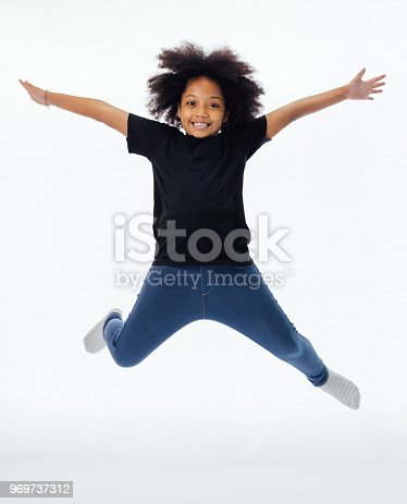 istock Happy and fun African American black kid jumping with hands raised isolated over white background 969737312