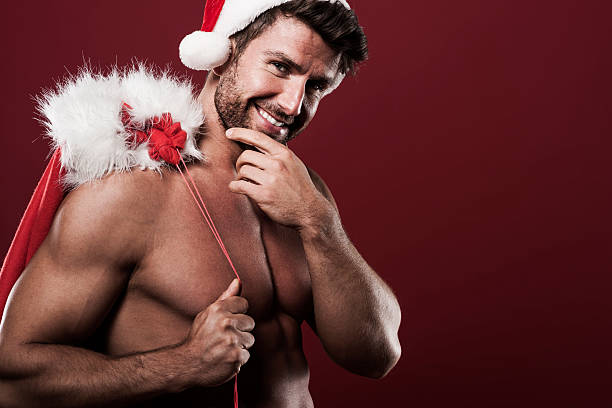 happy and handsome santa claus - naked santa claus stock pictures, royalty-free photos & images