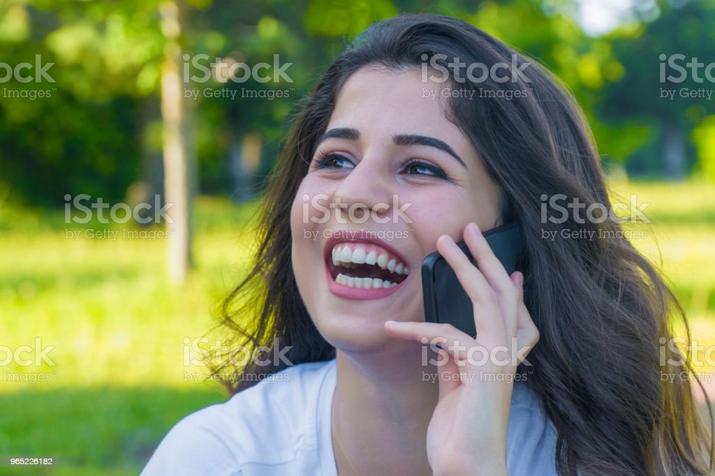 happy and laughing girl talking on the phone royalty-free stock photo