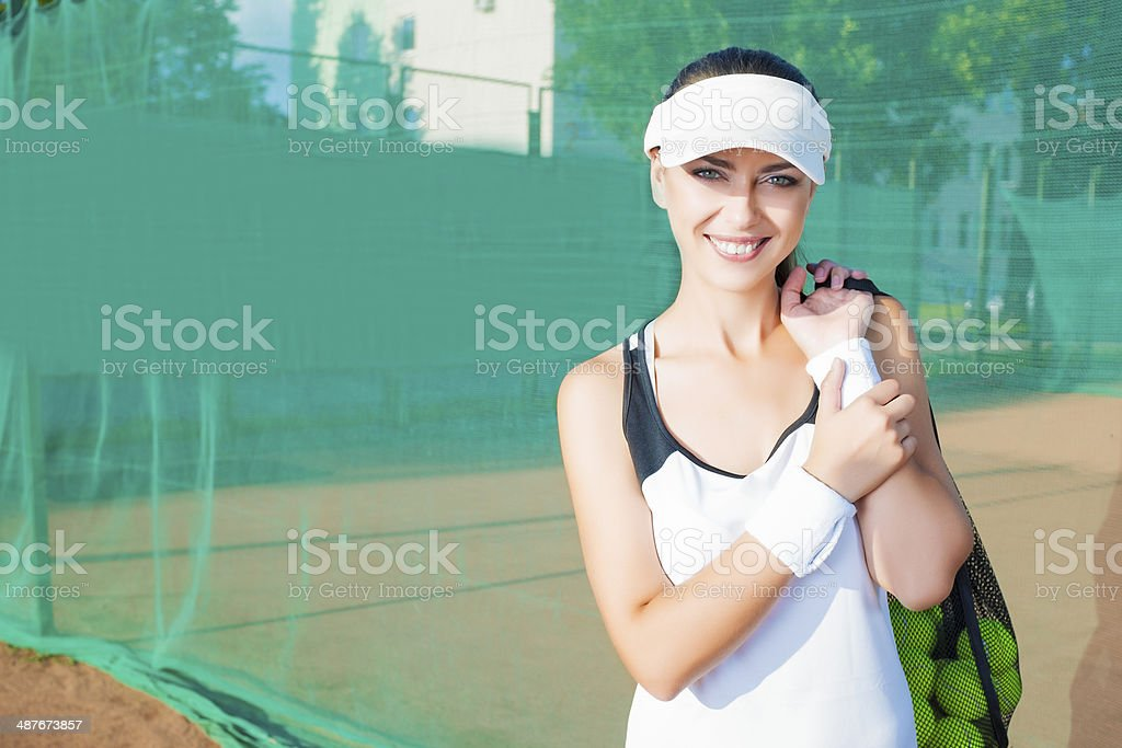 Happy and Positive Female Tennis Woman Holding Tennis Mesh Bag with...
