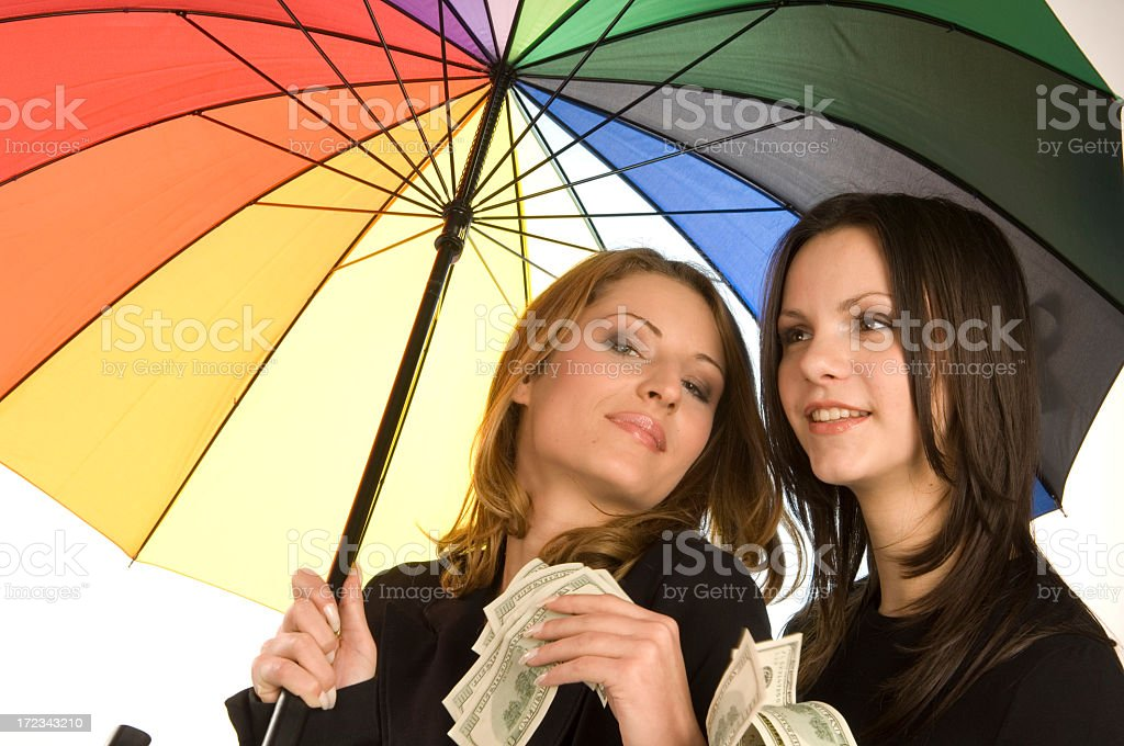 happy and rich under the umbrella royalty-free stock photo