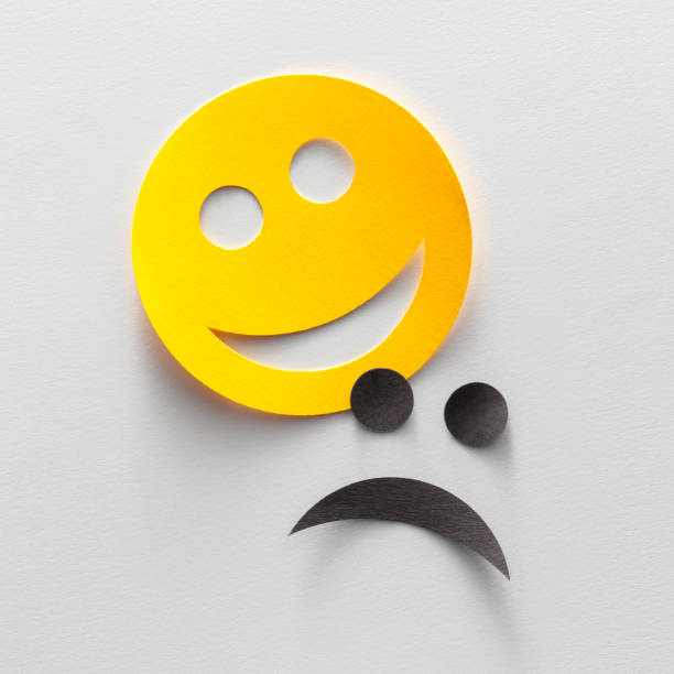 Happy and sad emoji smiley faces (or comedy and tragedy theater mask) Happy and sad emoji smiley faces or comedy and tragedy theater masks isolated on white background. negative image technique stock pictures, royalty-free photos & images