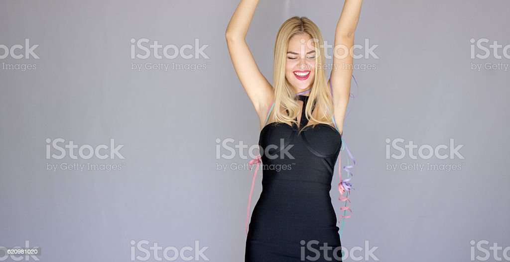 Happy and sexy young woman in evening dress dancing foto royalty-free