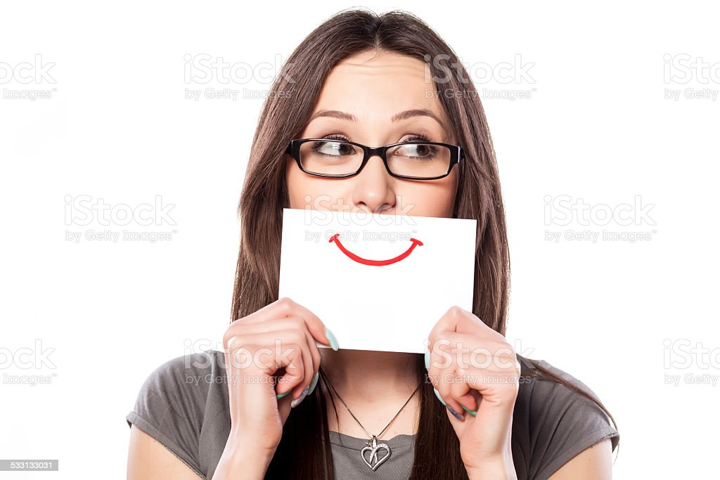 Happy and smiling girl with a smile painted on paper stock photo