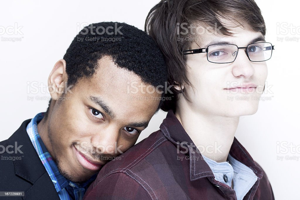 Happy and smiling interracial gay couple stock photo