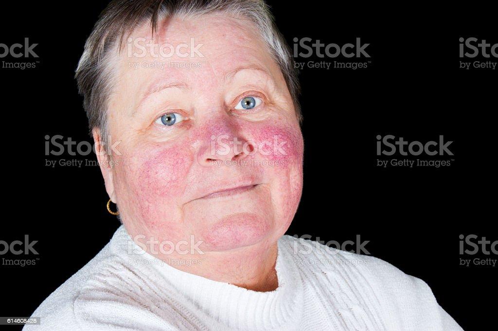 Happy and smiling senior woman, isolated studio portrait stock photo
