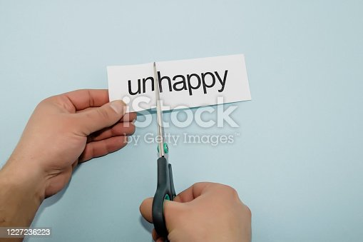 making the negative situation positive with writing paper and the sciccors that cut
