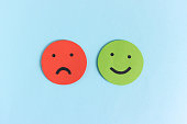 istock Happy and unhappy smileys for opinion 1135956040