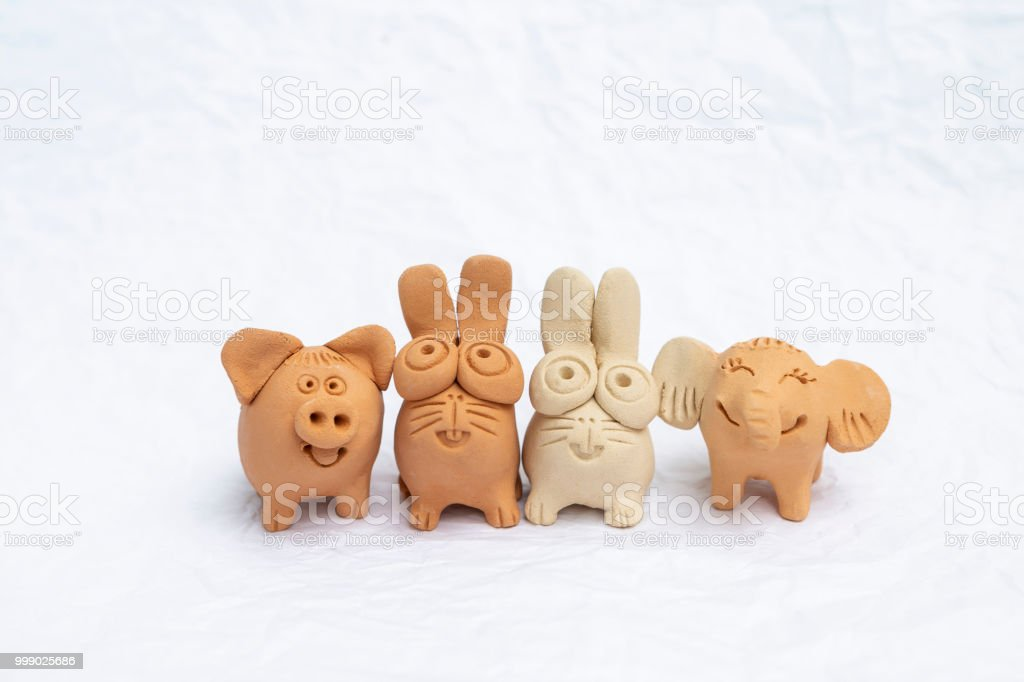 Happy animal sculpture isolate on white background, happy animal clay...
