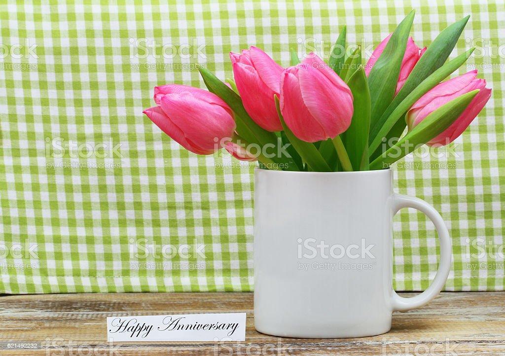 Happy Anniversary card with pink tulips in white mug Lizenzfreies stock-foto