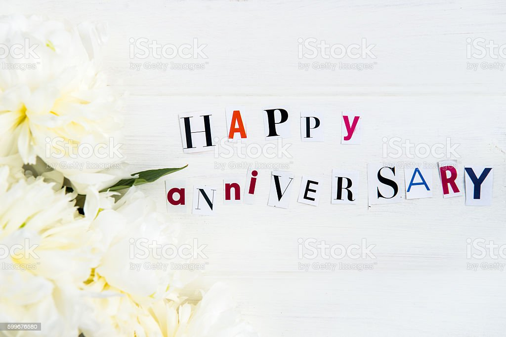 Happy anniversary letters cut out from magazines and white peoni