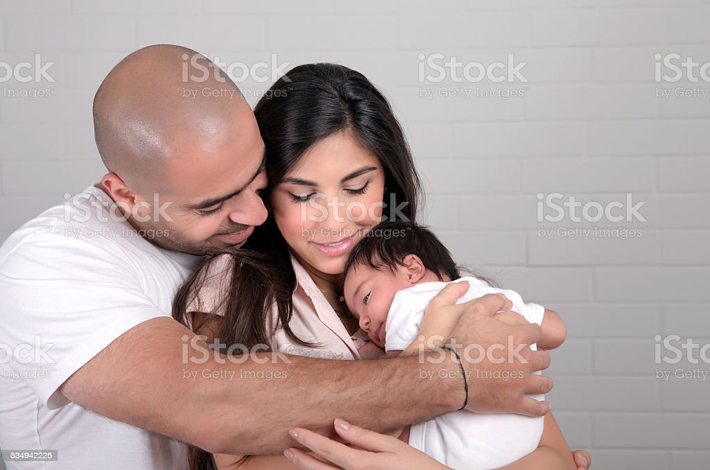 Happy arabic family at home stock photo
