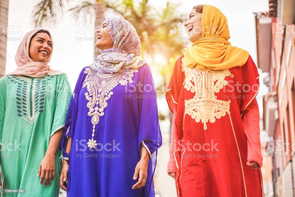 Happy Arabic Friends Walking In City Center Young Arabian